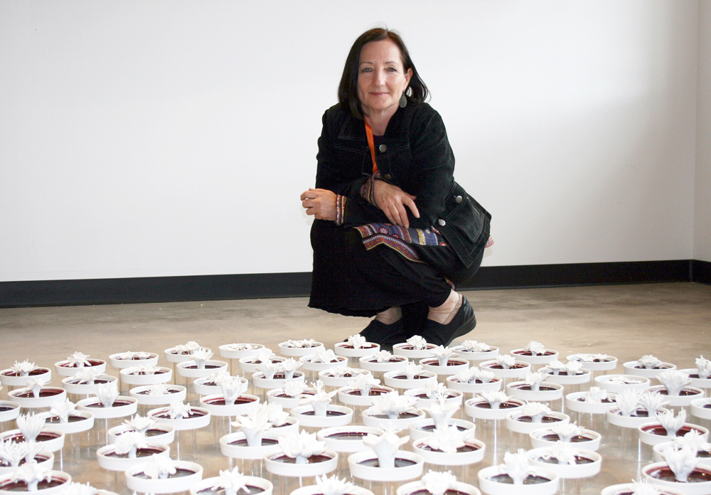 "Julie Bartholomew with installation of ""Rarely Seen."""