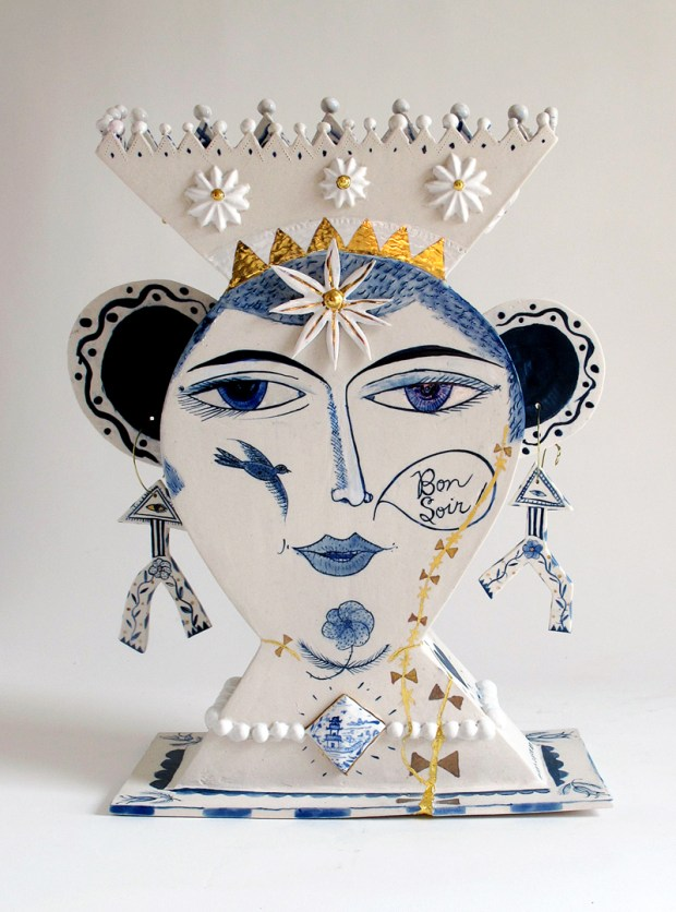"Mara Superior, ""Wounded Beauty"" 2014, porcelain, cobalt, glaze, gold luster, metal wire, 12 x 15 x 5.5""."