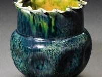 "George Ohr, ""Green & Indigo Large Dimpled Vase with Ruffled Rim, 5 x 5 x 5""."