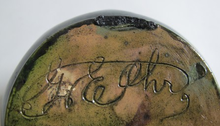 "George Ohr, ""Large Dimpled Vase with Ruffled Rim"" detail, 1898–1910, green and indigo glaze, script signature, 5 x 5 x 5""."