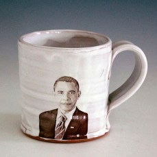 "Justin Rothshank, ""Barack Obama Mug"" 2016, earthenware, glaze, ceramic decals, 4 x 3.5""."
