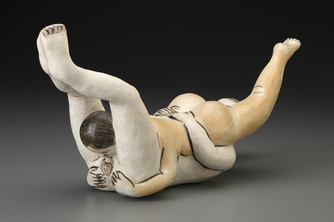 "Akio Takamori, ""Hanging Couple,"" 2002, porcelain, 7 x 13.25 x 5""."
