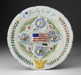"Mara Superior, ""July 4th"" 2016, porcelain, glaze, gold leaf, 12 x 12 x 1.5""."