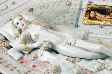 "Mara Superior, ""Venus of Urbino"" detail, 2018, porcelain, underglazes, oxides, glaze, gold leaf, decal, 13 x 19 x 3""."
