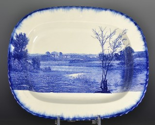 """Paul Scott, """"Scott's Cumbrian Blue(s), Indian Point No:6"""" 2017, in-glaze decal collage on pearlware shell edge platter c 1820. 14"""" x 11.5"""" (355 x 290mm)."""