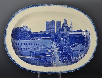 "Paul Scott, ""Scott's Cumbrian Blue(s), New American Scenery, Philadelphia No:3"" 2017 In-glaze screenprint (decal) on pearlware shell edge platter c 1820, 17.75 x 13.25"" (450mm x 355mm)"
