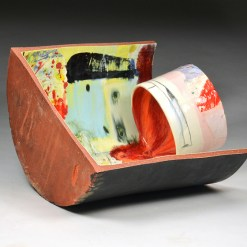 """Lauren Mabry, """"Contain and Deliver (into Black)"""" 2015, red earthenware, glaze, 13 x 19 x 17""""."""