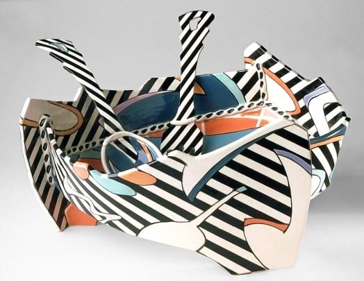 """Dorothy Hafner, """"Let's Toss Salad Server (with fork and spoon)"""" 1987, porcelain, engobe, glaze, 6.75 x 13.5 x 13.5""""."""