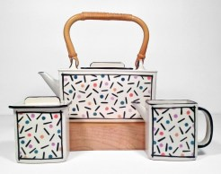 "Dorothy Hafner, ""Confetti Tea Set"" 1981, porcelain, engobe, glaze, teapot: 8.5 x 10.25 x 4.25"", creamer: 4.25 x 6 x 2.75""."