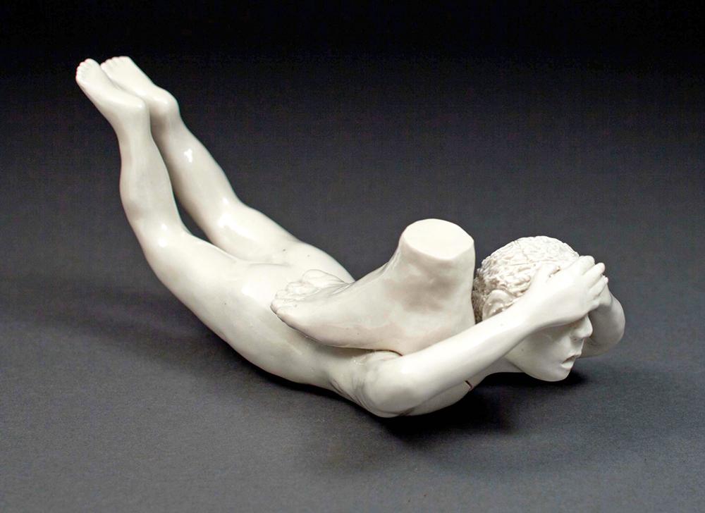 "Coille Hooven, ""Cracked Under Pressure"" 2003, porcelain, 4.25 x 9 x 4"". photo: Farrol Mertes"