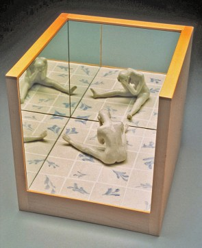 "Coille Hooven, ""Despair"" 1993, porcelain, mirror, wood, figure: 5 x 5.5 x 4"", box: 12 x 12 x 12""."