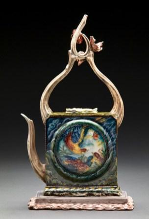 "Susan Thayer, ""Return"" 2016, teapot: porcelain, china paint, glazebase: lowfire stoneware, slip, 16 x 9 x 5""."