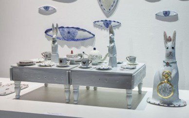 "Mara Superior, ""Queen Alice's Tea Table"" 2016, porcelain, 5 x 20 x 10""."