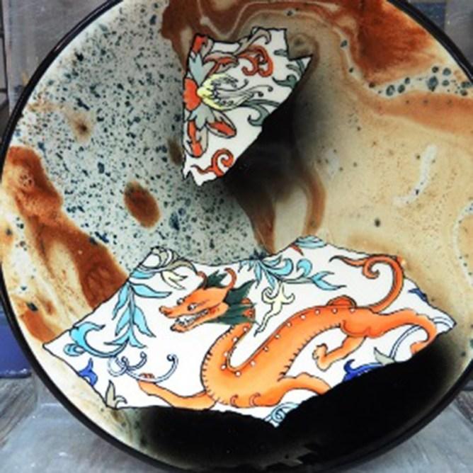 "Stephen Bowers, ""Dragon Fragment"" 2018, white earthenware, underglaze colors, glaze, 7.25 x 7.25 x 1.5""."