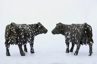"Elliott Kayser, ""Black Milk"" 2018, terra cotta, underglaze, feldspathic chips, 10 x 20 x 8""."