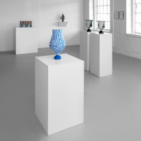 """Peter Pincus: Channeling Wedgwood at Ferrin Contemporary, North Adams, MA, 2018. (Front) Relieved, 2018, 17.25 x 9 x 9"""", colored porcelain. (Back Left) The Point of Confusion, 2018, 9.625 x 19 x 3.5"""" (total), colored porcelain. (Back Center) Vase, 2018, 15.75 x 8 x 8"""", colored porcelain. (Back Right) Calyx Krater: Excerpt from One Shows Two, Two Influence Twenty, 2018, 12.75 x 10.5 x 10.5"""" (each)."""
