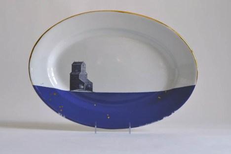 "Paul Scott, ""Cumbrian Blue(s), American Scenery, Grain Silo No. 2"", 2015, In-glaze decal, gold luster, J K Meakin ironstone platter c.1850, 13 x 18.25 x 1.75""."