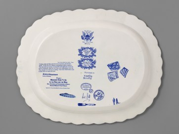 "Paul Scott, ""Scott's Cumbrian Blue(s), New American Scenery, The Uranium Series No. 1, Messa No: 1, Mine Road Cove, AZ"" back, 2019, in-glaze screen print (decal), on shell-edged pearlware platter c.1840 with uranium glass, 13.5 x 16.5 x 2""."