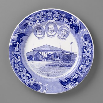 "Paul Scott, ""Scott's Cumbrian Blue(s), New American Scenery, The Angola 3"" 2019, in-glaze screen print (decal) on salvaged Syracuse China with pearlware glaze, 11x 11 x 1"""