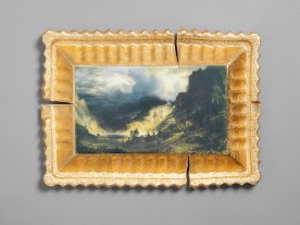 "Evan Hauser, ""Preservation & Use (A Storm in the Rocky Mountains, Mt. Rosalie, Albert Bierstadt, 1866)"", 2019, porcelain, digital ceramic print, gold leaf, 10.5 x 15 x 2.5""."