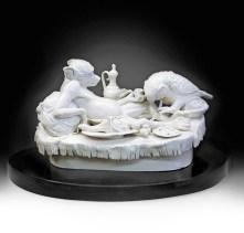 "Tricia Zimic, ""Sloth"", 2016, porcelain, glaze, granite pedestal, 6 x 12 x 7.5""."