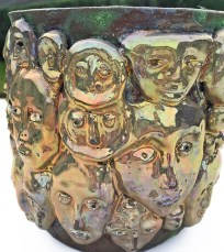 "Beatrice Wood, ""A Centennial Tribute Bowl with Lustre Masks"", c. 1991, earthenware clay, raku glaze, 7.5 x 8.5 x 9.5""."