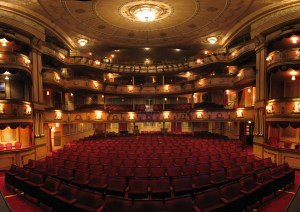 "Theatre Royal Brighton"" by Ian Muttoo from Mississauga, Canada - Theatre Royal Panorama, Brighton, UK. Licensed under CC BY-SA 2.0 via Wikimedia Commons."
