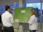 Autumn Vanden Berg explains her poster to Charlie Malone. Courtesy of the photographer.