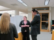 Kathryn Wilson explains her poster to Dr. Peter Bradley. Image of the Honors Program at Ferris State University.