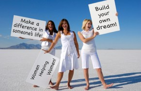 Three Beautiful Women In White On The Salt Flats Of Utah Holding Up Large White, Blank Signs For Marketer/Purchaser To Fill With Their Own Image/Words. Definitely SPACE FOR COPY.