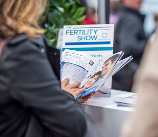 Visitor Looking Fertility Show Leaflet