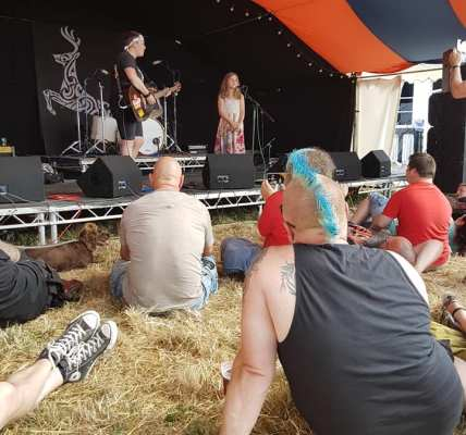 Jess Silk and friend on the Roy Stone Stage here at Deerstock. A crowded tent fo...