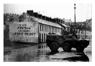 """Image may contain: outdoor, text that says """"YOU ARENOW ENTERING FREE DERRY"""""""