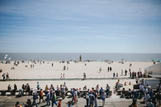 May be an image of one or more people and beach