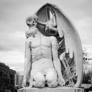 May be a black-and-white image of sculpture, monument and outdoors