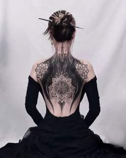 May be an image of one or more people and tattoo