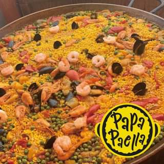 May be an image of paella and text