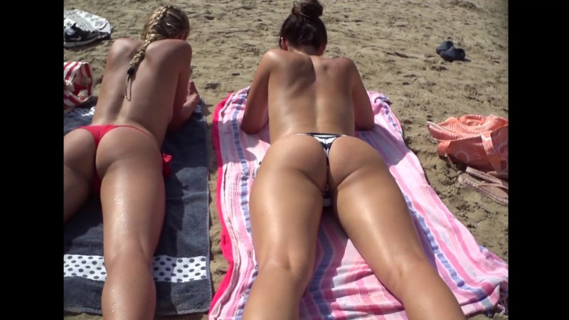 Two Teen At Beach Show Boobs And Asses