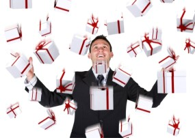 gifts falling down on a business man over a white background