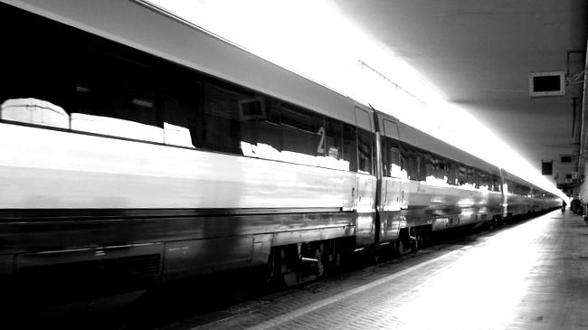 Train carriages passing - black and white