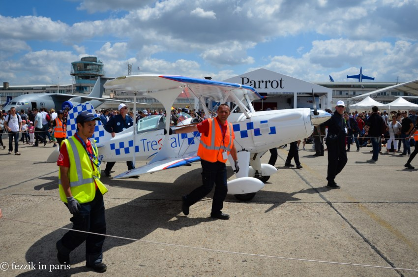 One of the aerobatic planes being returned to its display area.