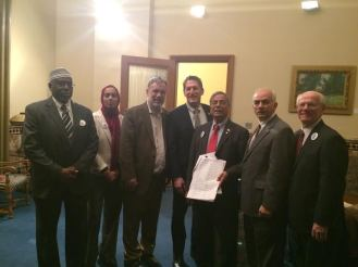 Walter Ruby (third from left) alongside Assemblyman Andrew Zwicker, who initiated the effort to sign the Pledge in the State Assembly, with Jacob Toporek, Dr. Ali Chaudry and other members of the Stand Up for Each Other team.
