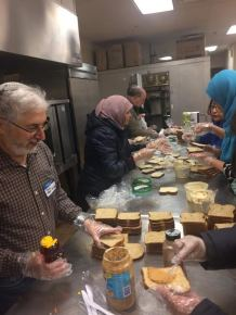 Muslims and Jews preparing food for the hungry at Temple Beth Shalom