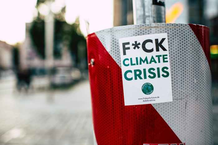sticker of climate crisis attached in metal