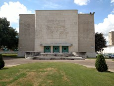The beautiful Texas mural and Art Deco lettering on the Performance Hall.