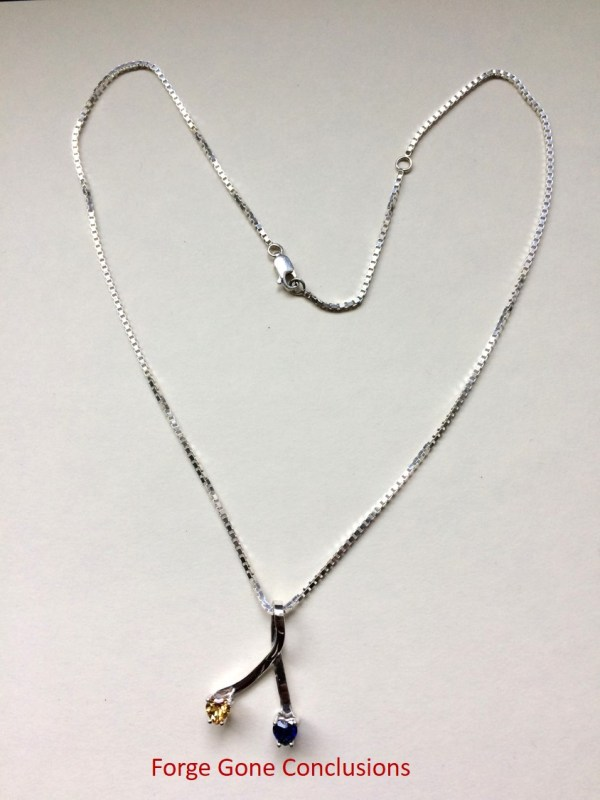 Heart Necklace with a Ribbon Pendant and two stones