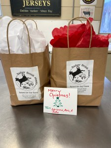Picture of two gift bags and a Christmas Card to support the importance of relationships.