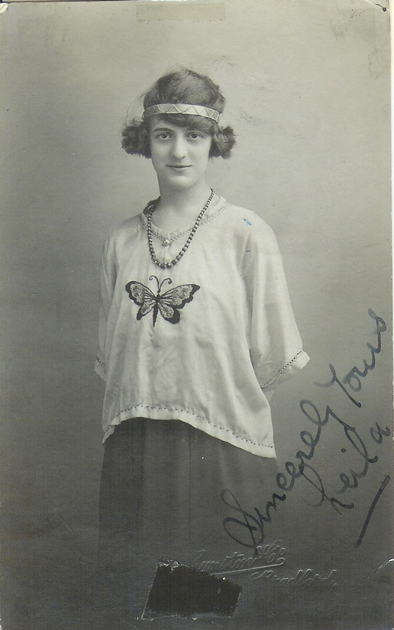 Woman posing with 1920s clothing, which includes an embroidered butterfly