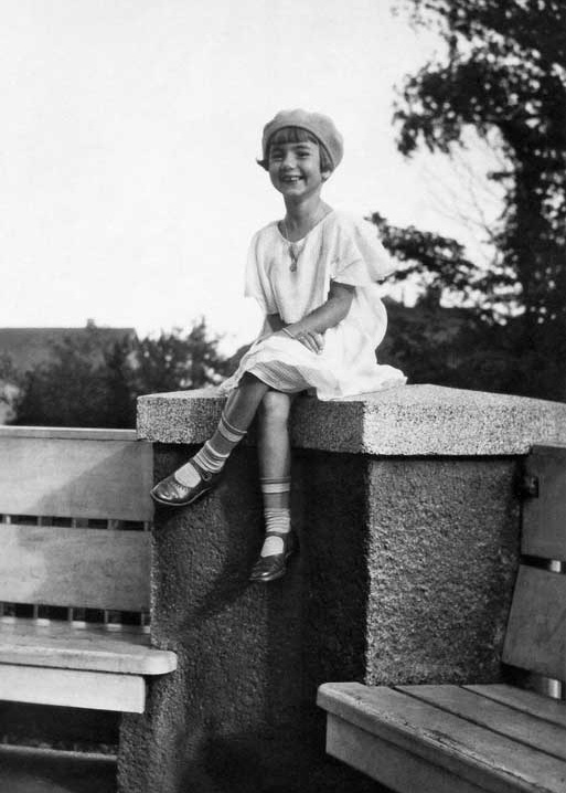 Young girl in 1930s fashion, sitting