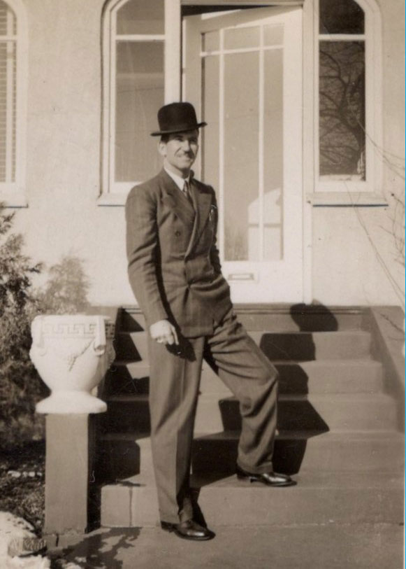 man from 1940s wearing hat